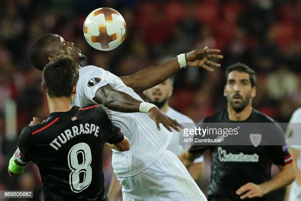 Athletic Bilbao's Spanish midfielder Ander Iturraspe challenges Ostersunds' Nigerian forward Alhaji Gero during the UEFA Europa League group F...