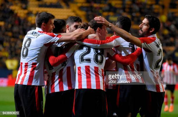 Athletic Bilbao's Spanish midfielder Inigo Cordoba celebrates with teammates after scoring during the Spanish league football match between...