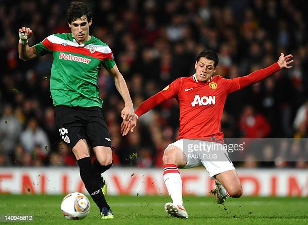 Athletic Bilbao's Spanish midfielder Javi Martínez vies with Manchester United's Mexican forward Javier Hernández during the UEFA Europa League round...