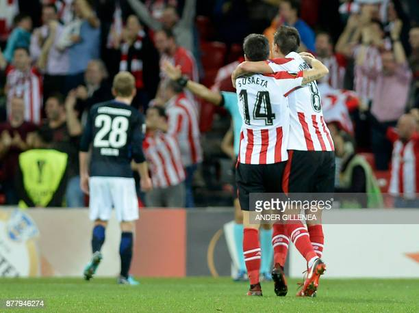 Athletic Bilbao's Spanish midfielder Markel Susaeta hugs Spanish midfielder Ander Iturraspe as they celebrate their team's third goal during the...