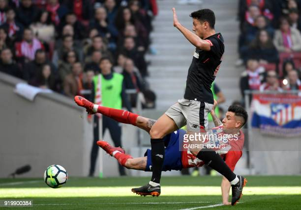 Athletic Bilbao's Spanish midfielder Mikel Vesga vies with Atletico Madrid's Uruguayan defender Jose Gimenez during the Spanish league football match...