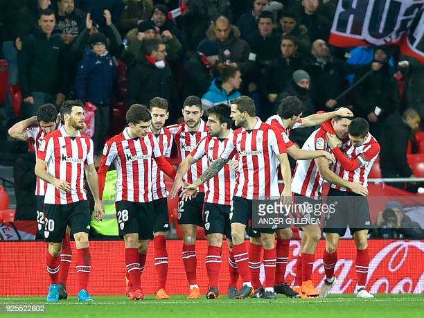 Athletic Bilbao's Spanish midfielder Oscar de Marcos celebrates a goal with teammates during the Spanish league football match Athletic Club Bilbao...