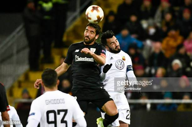 Athletic Bilbao's Spanish midfielder Raul Garcia and Ostersund's Brwa Ostersunds' midfielder from Iraq Brwa Nouri go to head the ball during the UEFA...