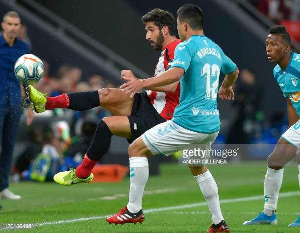 Athletic Bilbao's Spanish midfielder Raul Garcia vies with Osasuna´s Argentinian defender Facundo Roncaglia during the Spanish league football match...