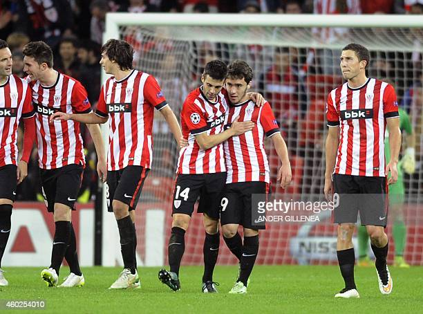 Athletic Bilbao's Unai Lopez celebrates with his teammate midfielder Markel Susaeta after scoring during the UEFA Champions League Group H football...