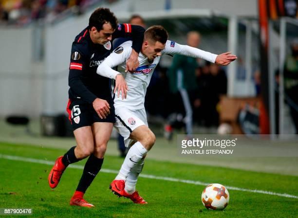 Athletic Bilbao's Yeray Alvarez fights for the ball with Zorya's Artem Sukhotskiy during the UEFA Europa League Group J football match between Zorya...