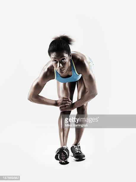 Athletic Black Female Stretching Leg Muscle