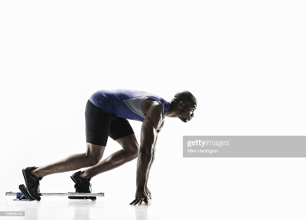 Athletic Black Male In Starting Blocks : Bildbanksbilder