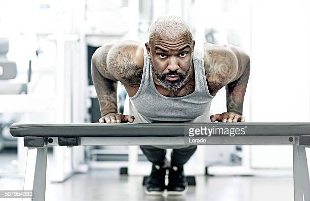 athletic black man exercising indoors