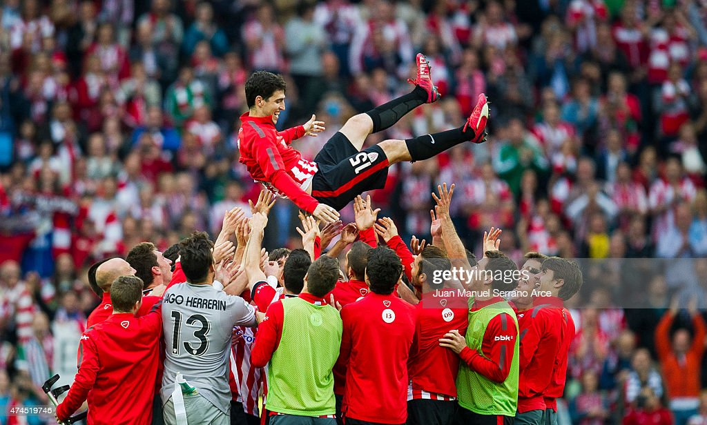 Athletic Club's players throw Andoni Iraola into the air after the La Liga match between Athletic Club Bilbao and Villarreal at San Mames Stadium on May 23, 2015 in Bilbao, Spain.