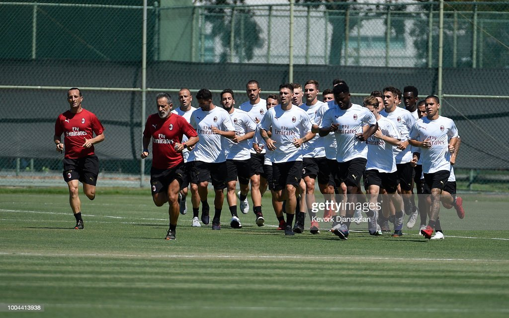 athletic coach bruno dominici 2nd l of ac milan leads the team during a