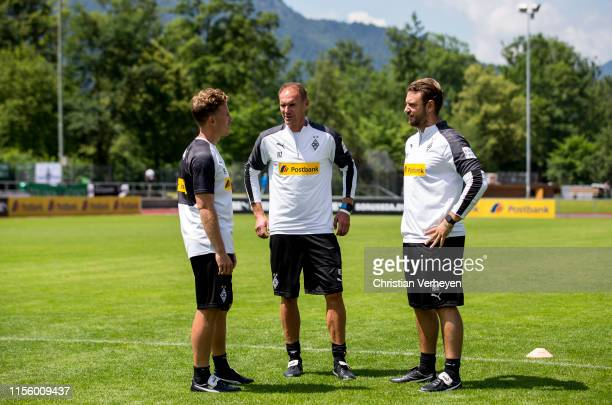 Athletic Coach Patrick Eibenberger Assistant Coach Alexander Zickler and Assistant Coach Rene Maric are seen during the Borussia Moenchengladbach...