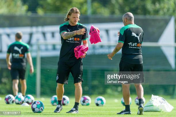 Athletic coach Patrick Eibenberger of Borussia Moenchengladbach and assistant coach Oliver Neuville of Borussia Moenchengladbach look on during day 2...