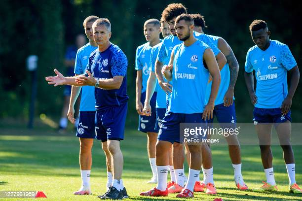 Athletic coach Werner Leuthard of FC Schalke 04 and Ahmed Kutucu of FC Schalke 04 looks on during the FC Schalke 04 training session on August 08,...