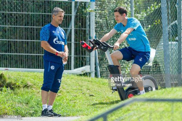 Athletic coach Werner Leuthard of FC Schalke 04 and Sebastian Rudy of FC Schalke 04 looks on during the FC Schalke 04 Training Camp on August 22,...