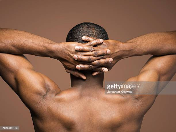 athletic dark skinned  male, hands on head - naked stock pictures, royalty-free photos & images