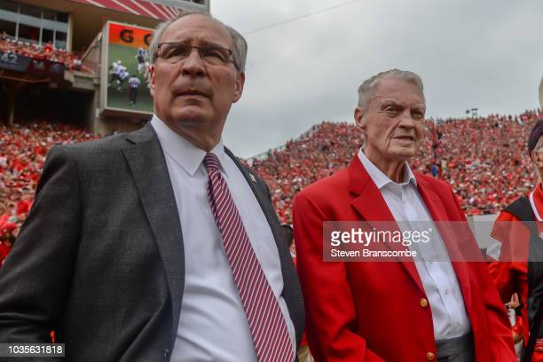 Athletic Director Bill Moos of the Nebraska Cornhuskers and former head coach Tom Osborne watch action against the Colorado Buffaloes at Memorial...