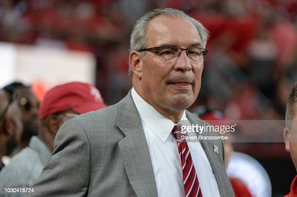 Athletic Director Bill Moos of the Nebraska Cornhuskers watches pregame activities before the game against the Akron Zips at Memorial Stadium on...
