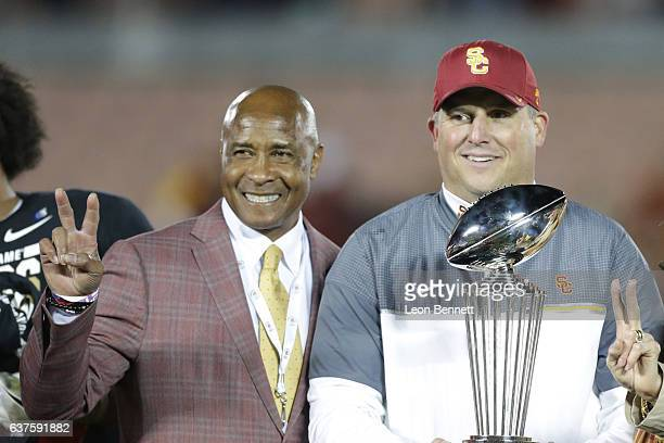 Athletic director Lynn Swann and Head coach Clay Helton of the USC Trojans celebrates after a 5249 comeback win over the Penn State Nittney Lions in...