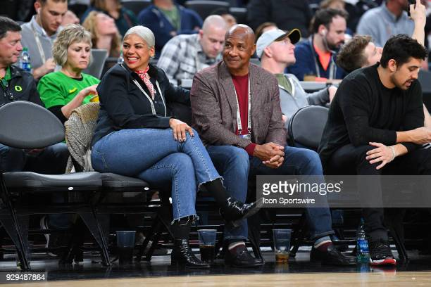 USC athletic director Lynn Swann and his wife Charena Swann look on during the quarterfinal game of the mens Pac12 Tournament between the Oregon...