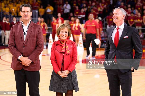 USC athletic director Mike Bohn president Carol Folt and USC Trojans head coach Andy Enfield look on before the college basketball game between the...