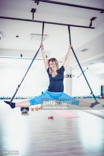 Athletic Female Doing Aerial Gym Exercises