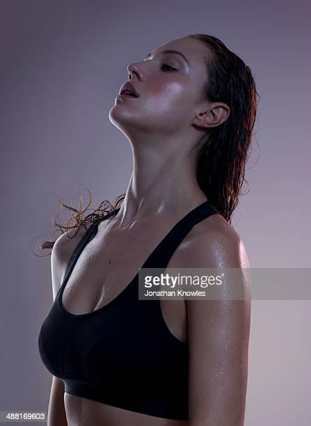 Athletic female exercising, sweaty