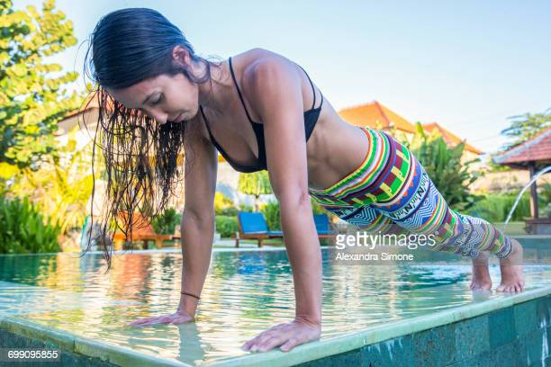 athletic female holds plank position in uluwatu, indonesia - stockings no shoes stock pictures, royalty-free photos & images