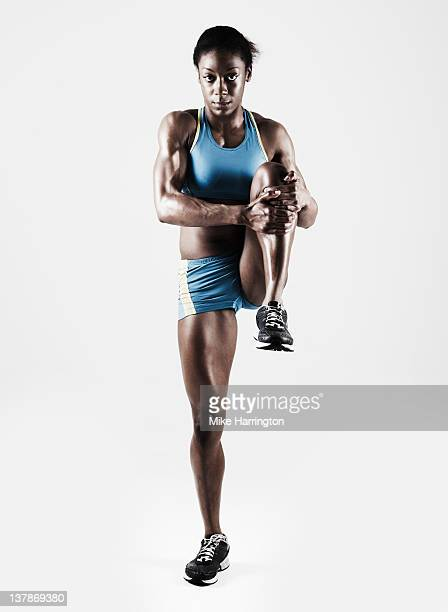 athletic female stretching leg - athletics stock pictures, royalty-free photos & images