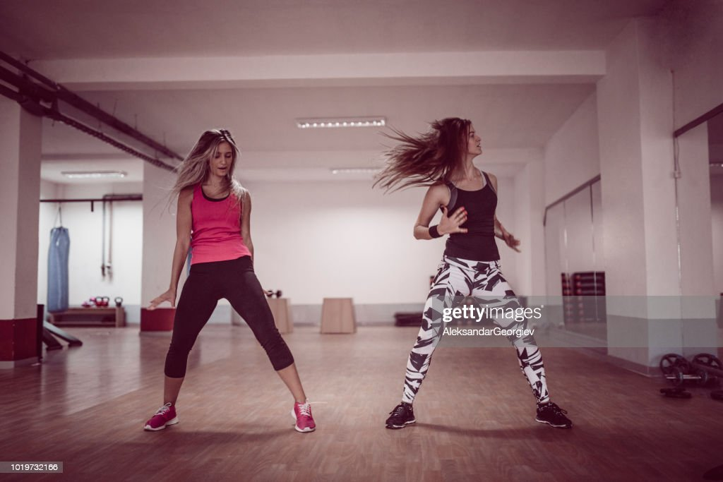 Athletic Females Working Out With Zumba Dancing Exercises In Gym : Stock Photo