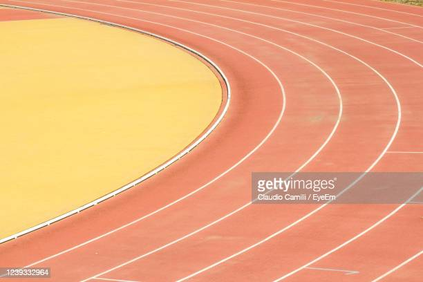 athletic field for athletics competitions. - parallel stock pictures, royalty-free photos & images