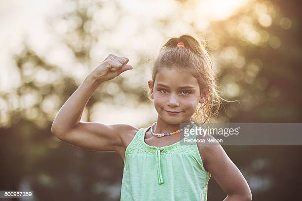 Athletic girl showing off her arm muscles