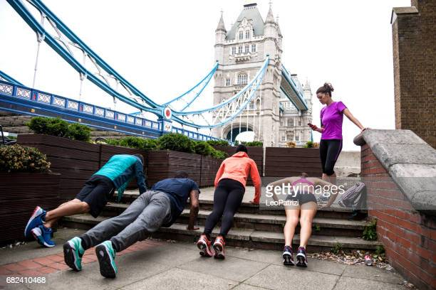 Athletic group of urban runner people exercising in London