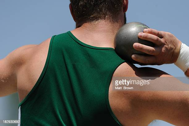 athletic male at shot put - shot put stock pictures, royalty-free photos & images