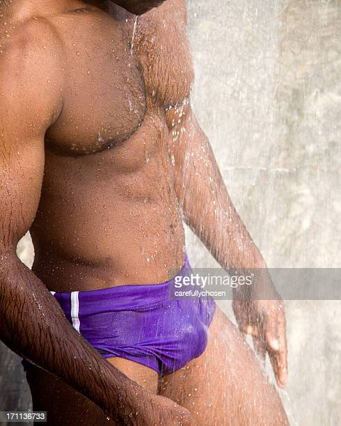 athletic male torso in shower