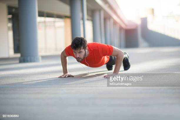 athletic man doing push ups - push ups stock pictures, royalty-free photos & images