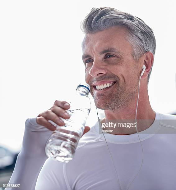 Athletic man drinking water