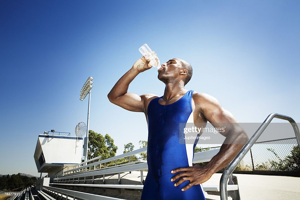 Athletic man drinking water : Stock Photo