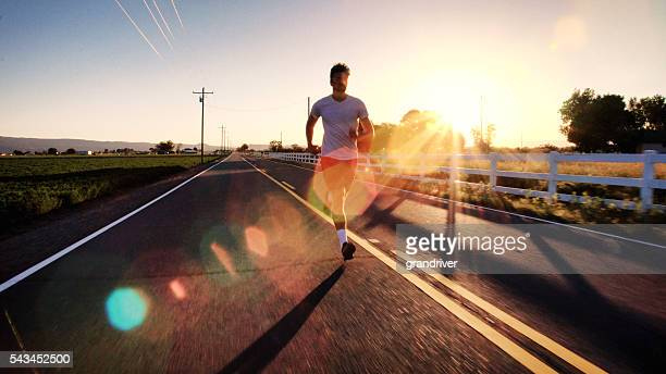 Athletic Man in His 20s Jogging on a Country Road