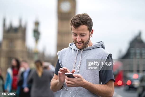Athletic man listening to music on his cell phone