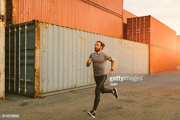 athletic man running in the city - armband stock pictures, royalty-free photos & images