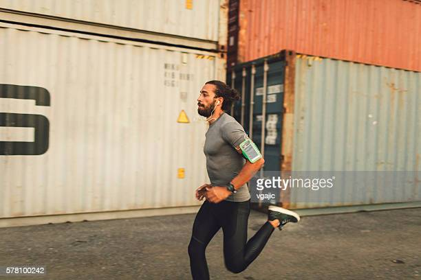 Athletic Man Running Outdoors.