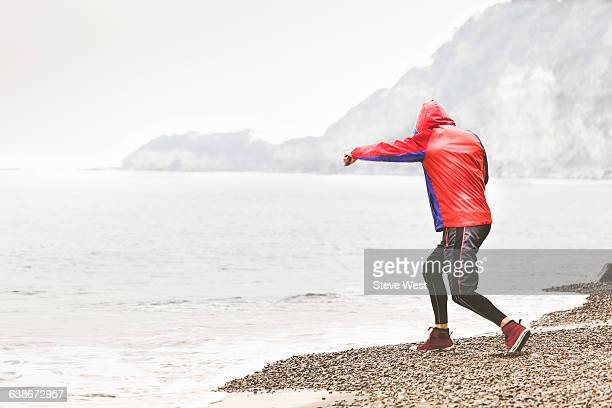 Athletic man shadowboxing on the beach