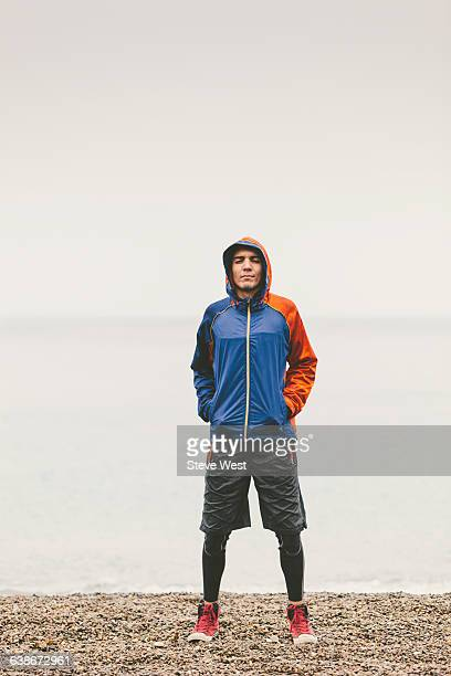 Athletic man standing on the beach