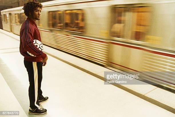 Athletic Man Waiting at Subway Platform