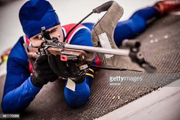 Athletic man with biathlon rifle
