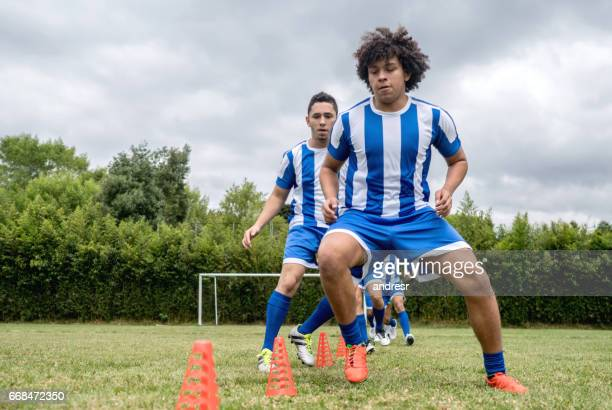 Athletic men in soccer training