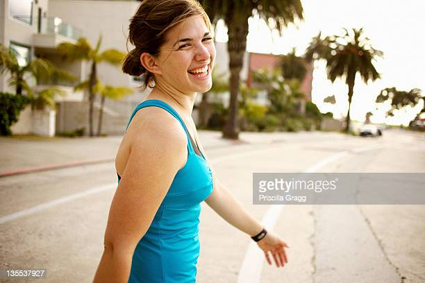 Athletic mixed race woman crossing street