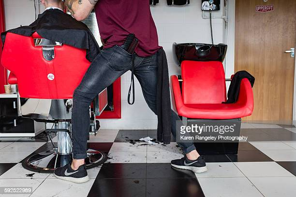 Athletic moves from barber Will as he comes at his clients hair from different angles