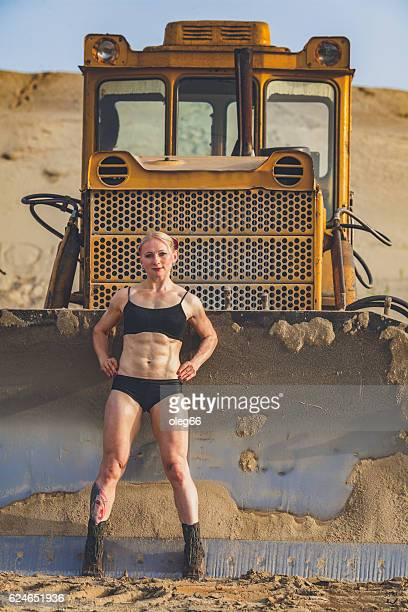 athletic muscular woman - tractor stock pictures, royalty-free photos & images